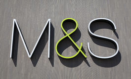 Marks and Spencer logotype. York, United Kingdom - April 15, 2014: Marks&Spencer logotype on the wall of the M&S store in York, UK. Marks&Spencer plc is a major Royalty Free Stock Image