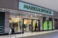 Marks & Spencer shop. A woman enters a Marks and Spencer shop in Glasgow, UK Stock Photos