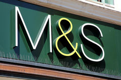 Marks & Spencer Sign. Portsmouth, United Kingdom, Apr 22, 2011 : Marks & Spencer (M & S) logo advertising sign outside one of its retail supermarket stores in Royalty Free Stock Photo
