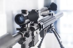 Marksman Rifle with Bipod on Table stock photo