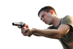 The marksman from a pistol isolated. The man shoots from a pistol on a white background Stock Image