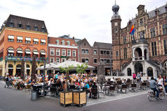 Markt plein Venlo. VENLO, THE NETHERLANDS - MAY 2016: People enjoying a drink on the terraces of the Markt square in front of the old city hall royalty free stock photo