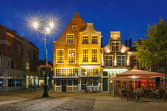 Markt square at night in Delft, Netherlands Stock Images