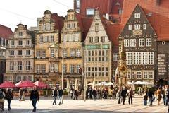 Marktplatz (Market square) in Bremen, Germany. BREMEN, GERMANY - SEPTEMBER 16, 2010: Locals and tourists walking past medieval Roland statue on Marktplatz in Royalty Free Stock Image