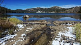 Marlette Lake in the Autumn after the first snow fall. Overview of the Marlette Lake in the Autumn, highlighting yellow vegetation and first snow on the ground Stock Images