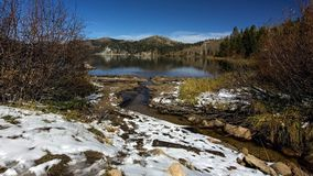 Marlette Lake in the Autumn after the first snow fall. Overview of Marlette Lake in the fall, highlighting yellow vegetation and a thin layer of snow on the Stock Images