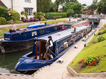 Narrow Boats in Marlow Lock, River Thames, England. Narrow boats waiting in Marlow Lock on the River Thames. Marlow, Buckinghamshire, England Royalty Free Stock Image
