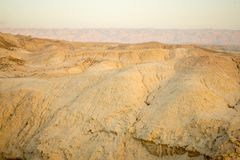 Marlstone rock formation, in Neot HaKikar. Sunrise view of Marlstone rock formation, in Neot HaKikar, northern Arava valley, south of the Dead Sea, Southern Royalty Free Stock Photo