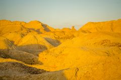 Marlstone rock formation, in Neot HaKikar. Sunrise view of Marlstone rock formation, in Neot HaKikar, northern Arava valley, south of the Dead Sea, Southern Stock Photo