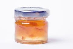Marmalade. A pot of orange marmalade jam on a white background Royalty Free Stock Image