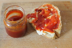 Marmalade for breakfast. Jar of marmalade and a piece of bread Royalty Free Stock Photos