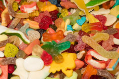 Marmalade chewing candyes. Rainbow colored marmalade chewing candyes royalty free stock images