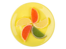 Marmalade in form of citrus fruits on saucer on white Royalty Free Stock Photography