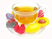 Marmalade gelatin fruits and tea cup Royalty Free Stock Images