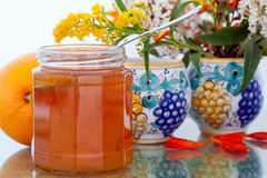 Marmalade, oranges and flowers Royalty Free Stock Photos