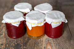 Marmalade. Strawberry and apricot marmalade on a wooden table Stock Photo