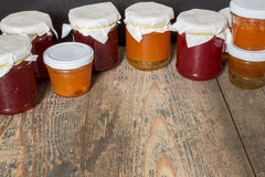 Marmalade. Strawberry and apricot marmalade on a wooden table Stock Image