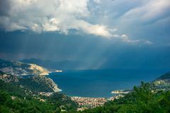 Marmaris bay landscape with sunbeam and cloudy sky at sunset.Turunc, Marmaris, Turkey. Holiday and summer background. Curvy road. And tree detail stock images