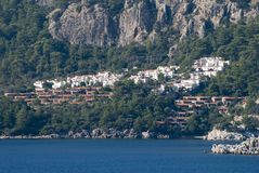 Marmaris Resort Town Outskirts. Marmaris resort town residential district built between coast and mountain cliff Turkey Royalty Free Stock Images