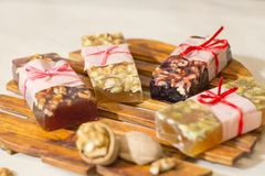 Marmelade bars with nuts. Granola organic snacks with fruits Stock Photo