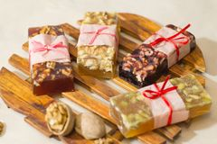 Marmelade bars with nuts. Granola organic snacks with fruits Royalty Free Stock Photography