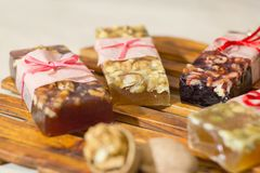 Marmelade bars with nuts. Granola organic snacks with fruits Royalty Free Stock Images
