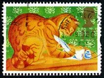 Marmelade Cat Writing eine Buchstabe-Briefmarke Stockbild