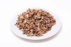 Marmelos secos de Aegle del té de la fruta de Bael aislados en el fondo blanco Imágenes de archivo libres de regalías