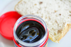 Marmite. Food spread close up against slices of sandwich bread for breakfast royalty free stock photography