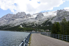 Marmolada and its lake. Overview of the dam of Lake fedaia with  Marmolada mountain and its glacier, in Italy Stock Photo