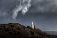 Marmonne la baie de Swansea de phare Photos stock