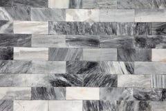 MarmorBacksteinmauerhintergrund Stockfoto