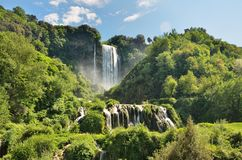 Marmore Falls is a man-made waterfall created by the ancient Romans located near Terni, Italy. The Cascata delle Marmore Marmore Falls is a man-made waterfall royalty free stock photography