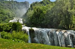 Marmore Falls is a man-made waterfall created by the ancient Romans located near Terni, Italy. The Cascata delle Marmore Marmore Falls is a man-made waterfall stock photography