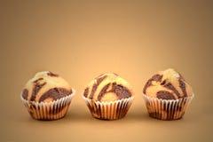 Marmorerade bilder för chokladmuffinmateriel Royaltyfria Bilder