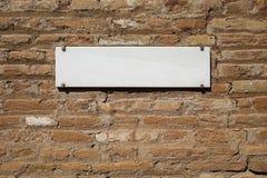 Marmorplatta på tegelstenväggen Fotografering för Bildbyråer