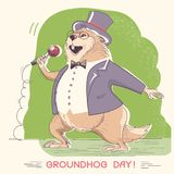 Marmot in gentleman clothes with microphone. Groundhog day holi Royalty Free Stock Photo