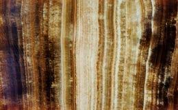 Marmurkowatej Onyksowej kopalina kamienia wzoru tekstury makro- widok Piękny brown koloru tło ablegrował chalcedon rozmaitość Zdjęcia Royalty Free