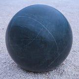 Marmurkowaty kamienny sfery czerni granit zdjęcie stock
