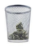 Marnowanie pieniądze obraz stock