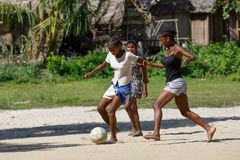 Malagasy children play soccer, Madagascar stock images