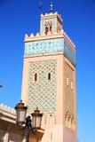 Maroc africa minaret   the blue    street lamp. In maroc africa   minaret and the blue  sky Royalty Free Stock Image