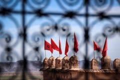Maroccan flags seen. Through inticate window grate Stock Photos