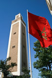 Maroccan tower and flag Royalty Free Stock Images