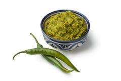 Marokkaanse groene harissa en verse groene paprika's Stock Afbeelding
