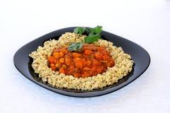 Marokkanisches Gemüseeintopfgericht mit Reismelde. lizenzfreie stockfotos