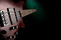 Maroon bass guitar Stock Images
