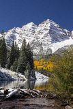Maroon Belles Colorado. The Maroon Belles of Colorado near Aspen are some of the most photographed mountains in the United States. This photograph shows the royalty free stock images