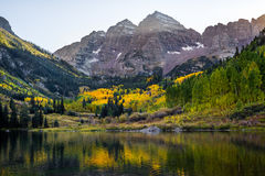 Maroon bells aspen colorado. Mountain and lake view in the autum fall of maroon bells in aspen colorado rocky mountains - yellow leaves stock images