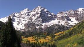 Maroon Bells in Autumn. An early snow coats scenic maroon bells near aspen colorado in fall stock video